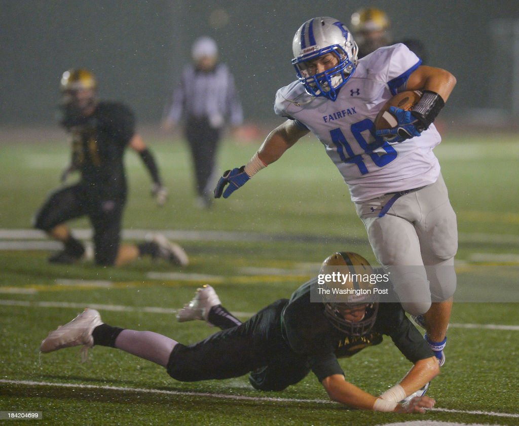 Langley defensive back Garrett Collier left brings down Fairfax running back Max Kavaljian after long 4th quarter gain during Langley's defeat of...