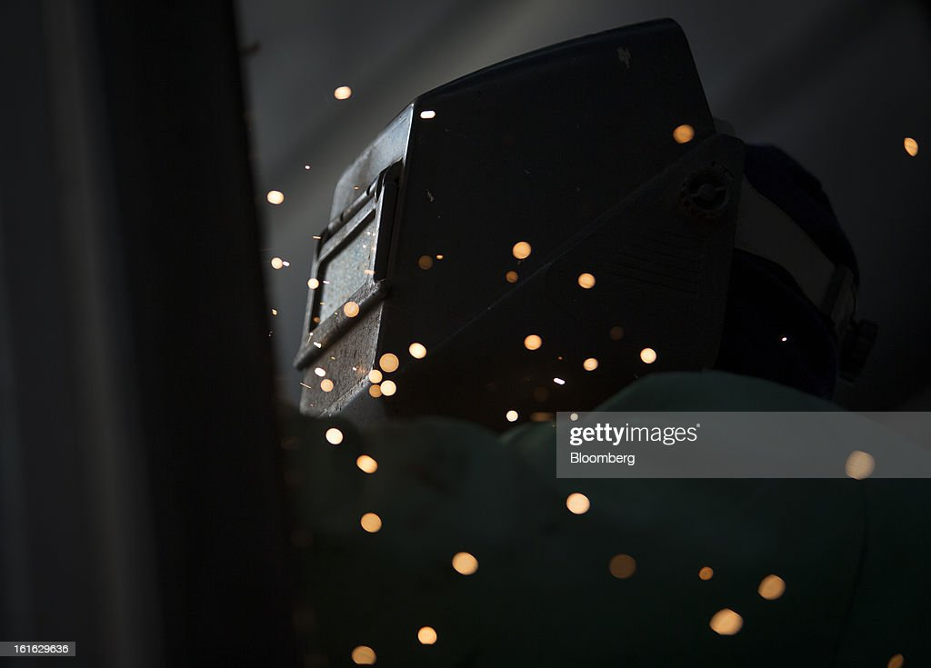 Langley Ronnie, a Capsys Corp. employee, MIG welds the frame of a modular housing unit at the Brooklyn Navy Yard in the Brooklyn borough of New York, U.S., on Wednesday, Feb. 13, 2013. Capsys Corp., which specializes in prefabricated buildings, will be building micro-unit apartments in New York City. Photographer Scott Eells/Bloomberg via Getty Images