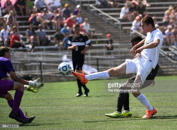 CHANTILLY VA JUNE Langley Saxons midfielder Sam Golan gets the ball past Battlefield Bobcats keeper Michael Barbuti during the Virginia State High...
