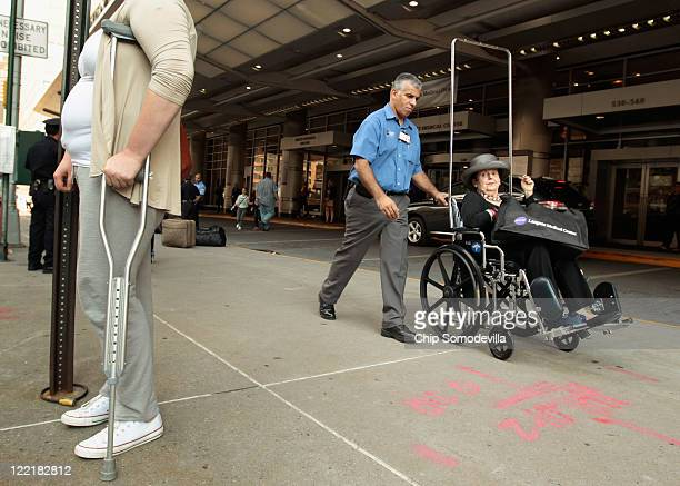 Langone Medical Center employee Danny Hernandez helps an 83yearold patient leave after the hosptial was ordered to to discharge or move about 400...