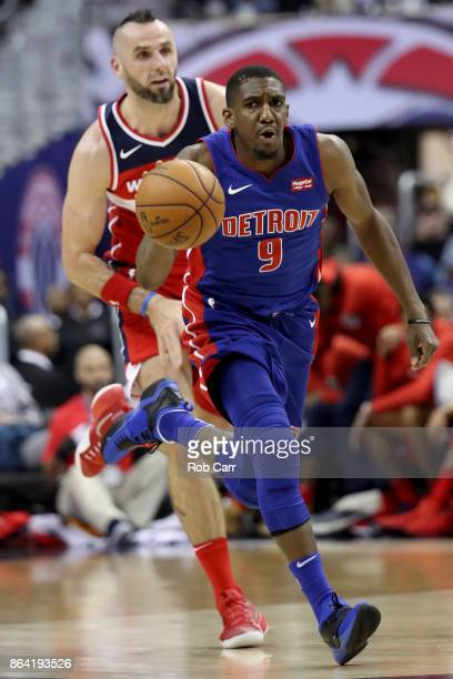 Langston Galloway of the Detroit Pistons dribbles the ball in front of Marcin Gortat of the Washington Wizards at Capital One Arena on October 20...