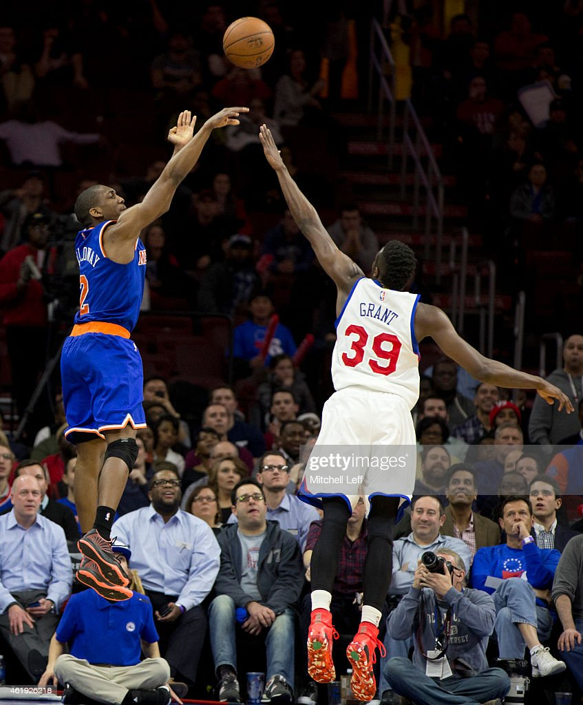 Langston Galloway #2 of the New York Knicks makes a three point basket in the closing seconds of the game with Jerami Grant #39 of the Philadelphia 76ers defending on the play on January 21, 2015 at the Wells Fargo Center in Philadelphia, Pennsylvania.