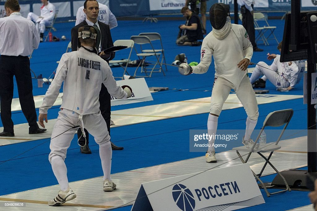 Lanigan-O Keeffe of Ireland (L) and Hefny Yasser of Egypt compete in the men's fencing final at the World Championship in modern pentathlon at Olympic Sports Complex in Moscow, Russia, on May 28, 2016.