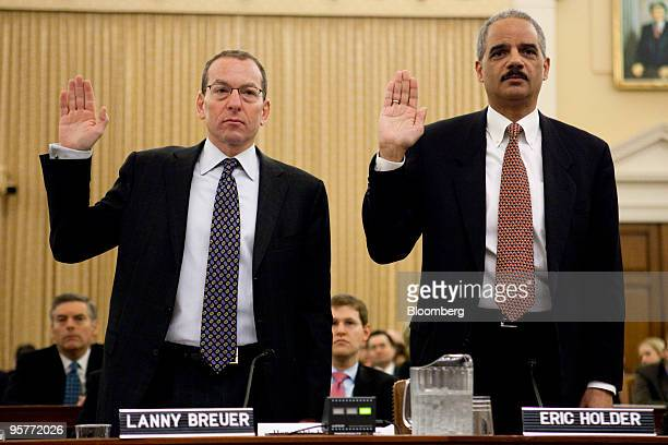 Lanny Breuer assistant US attorney general left and Eric Holder US attorney general are sworn in before a Financial Crisis Inquiry Commission hearing...