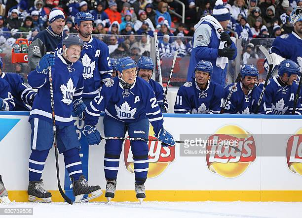 Lanny McDonald and Borje Salming of the Toronto Maple Leafs Alumni rest during at stoppage against the Detroit Red Wings Alumni at the 2017 Rogers...