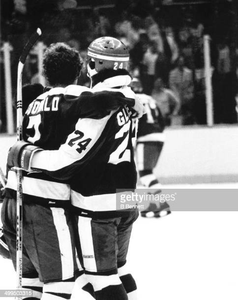 Lanny McDonald and Brian Glennie of the Toronto Maple Leafs celebrate a goal against the New York Islanders during Game 7 of the Stanley Cup Quarter...