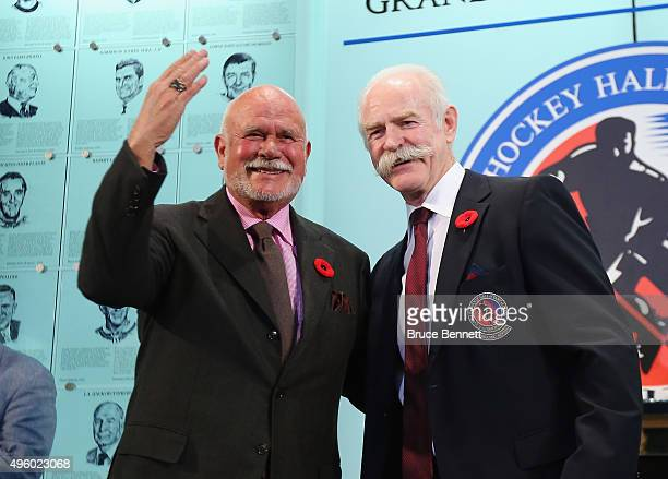Lanny McDonald Chairman of the Hockey Hall of Fame presents Peter Karmanos Jrwith his Hall of Fame ring at a photo op at the Hockey Hall of Fame and...