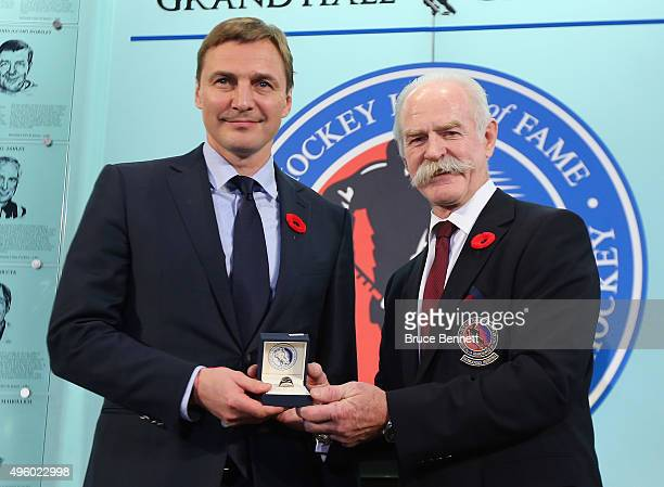 Lanny McDonald Chairman of the Hockey Hall of Fame presents Sergei Fedorov with his Hall of Fame ring at a photo op at the Hockey Hall of Fame and...