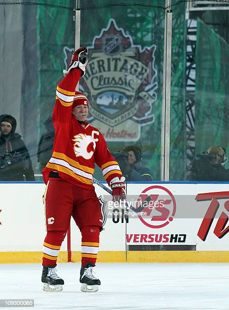 Lanny McDonald of the Calgary Flames Alumni celebrates his penalty shot goal against the Montreal Canadiens Alumni during the Alumni game held as...