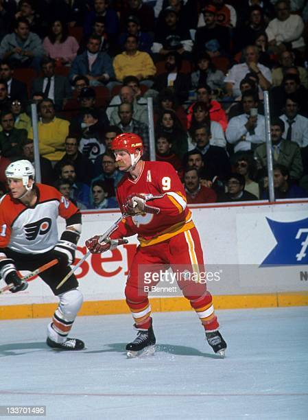 Lanny McDonald of the Calgary Flames defends against Dave Brown of the Philadelphia Flyers on November 10 1989 at the Spectrum in Philadelphia...