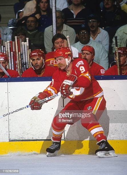 Lanny McDonald of the Calgary Flames passes the puck during an NHL game circa 1989