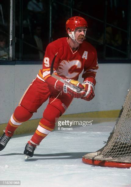 Lanny McDonald of the Calgary Flames skates around the net during an NHL game circa 1986