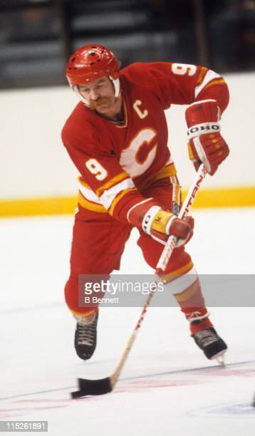Lanny McDonald of the Calgary Flames skates with the puck during an NHL game circa 1987
