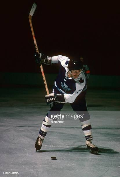 Lanny McDonald of the Toronto Maple Leafs rears back to take a slap shot during an NHL game circa 1975