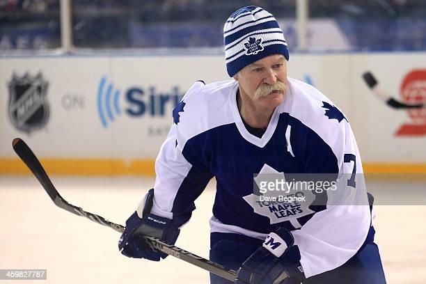 Lanny McDonald Toronto Maple Leafs Alumni follows the play against the Detroit Red Wings Alumni during the 2014 Bridgestone NHL Winter Classic Ð...