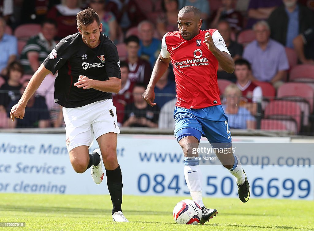 Lanre Oyebanjo of York City moves away with the ball from <a gi-track='captionPersonalityLinkClicked' href=/galleries/search?phrase=Darren+Carter+-+Soccer+Player&family=editorial&specificpeople=4520776 ng-click='$event.stopPropagation()'>Darren Carter</a> of Northampton Town during the Sky Bet League Two match between York City and Northampton Town at Bootham Crescent on August 3, 2013 in York, England.