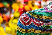Detalhe das lantejoulas na vestimenta do caboclo de lança durante o encontro de maracatus do baque solto, evento que acontece na segunda feira de carnaval, onde os maracatus se apresentam na cidade de