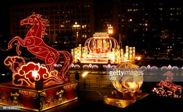 A lantern decoration is illuminated at Wangfujing Street on January 9 2014 in Beijing China Chinese people are preparing for the Spring Festival the...