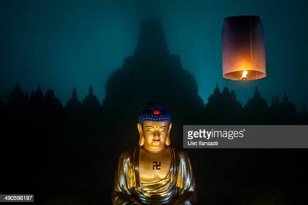 A lantern flies into the air at Borobudur temple during celebrations for Vesak Day on May 15 2014 in Magelang Central Java Indonesia Vesak is...