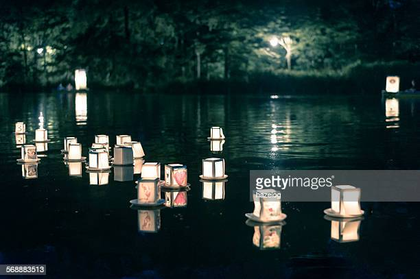 Lantern floating on the night lake