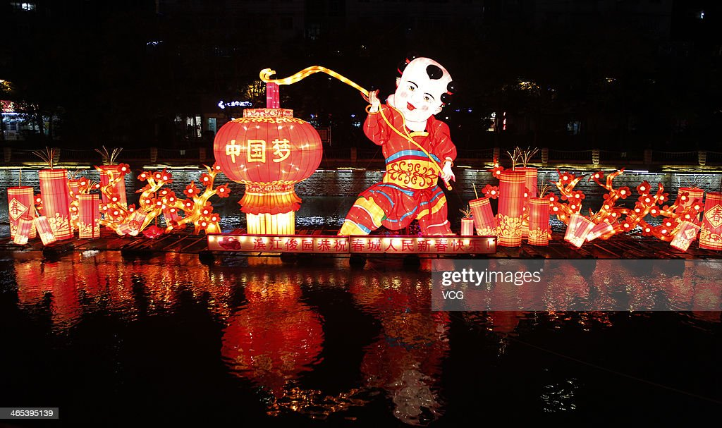 A lantern is illuminated on Panlong River on January 26, 2014 in Kunming, China. Chinese people are preparing for the Spring Festival, the year of horse, which will fall on January 31 according to Chinese calendar.
