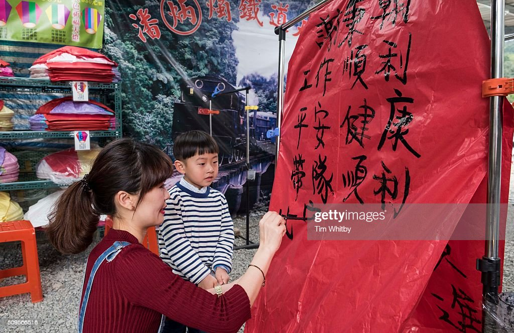 A lantern is painted with wishes for the new year in preperation for the Pingxi Sky Lantern Festival on February 11, 2016 in Pingxi District, New Taipei City, Taiwan. The event is the first of three organised lantern releases and falls on the 4th day of the Lunar New Year. The theme for the launch was children and young participants were encouraged to place their fingerprints on their lanterns as a symbolic representation of their wishes.