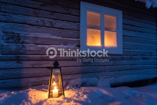 Lantern outside a cottage with frosty window : Stock Photo