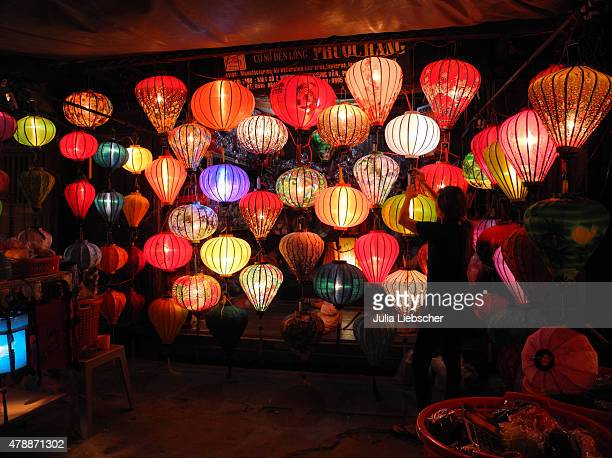 A lantern shop lights up its products on April 21 2015 in Hoi An Vietnam Hoi An is a city on Vietnam's central coast known for its wellpreserved...