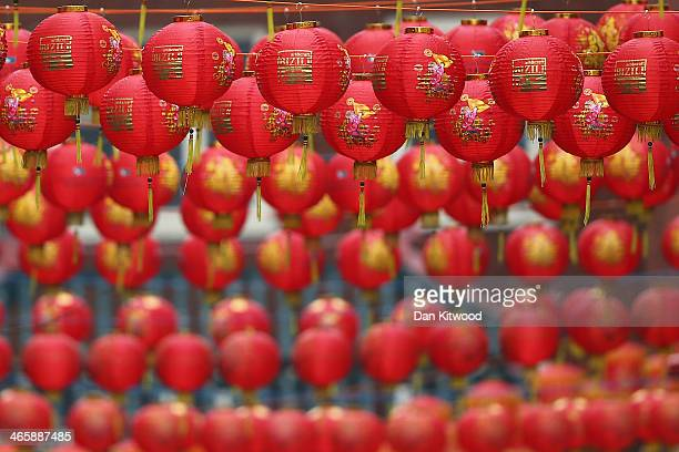 Lanterns hang above the street in China Town on January 30 2014 in London England The Chinese Lunar New Year of Horse also known as the Spring...