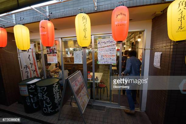 Lanterns hang outside a Kushikatsu Tanaka restaurant operated by Kushikatsu Tanaka Co in Tokyo Japan on Thursday April 20 2017 Kushikatsu...