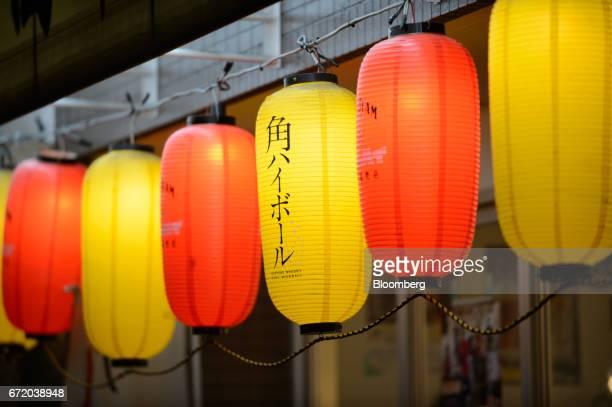 Lanterns hang outside a Kushikatsu Tanaka restaurant operated by Kushikatsu Tanaka Co stands in Tokyo Japan on Thursday April 20 2017 Kushikatsu...