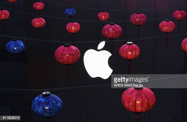 Lanterns hang outside an Apple store in a mall in Beijing on February 23 2016 Apple on February 18 launched its mobile payments service Apple Pay in...