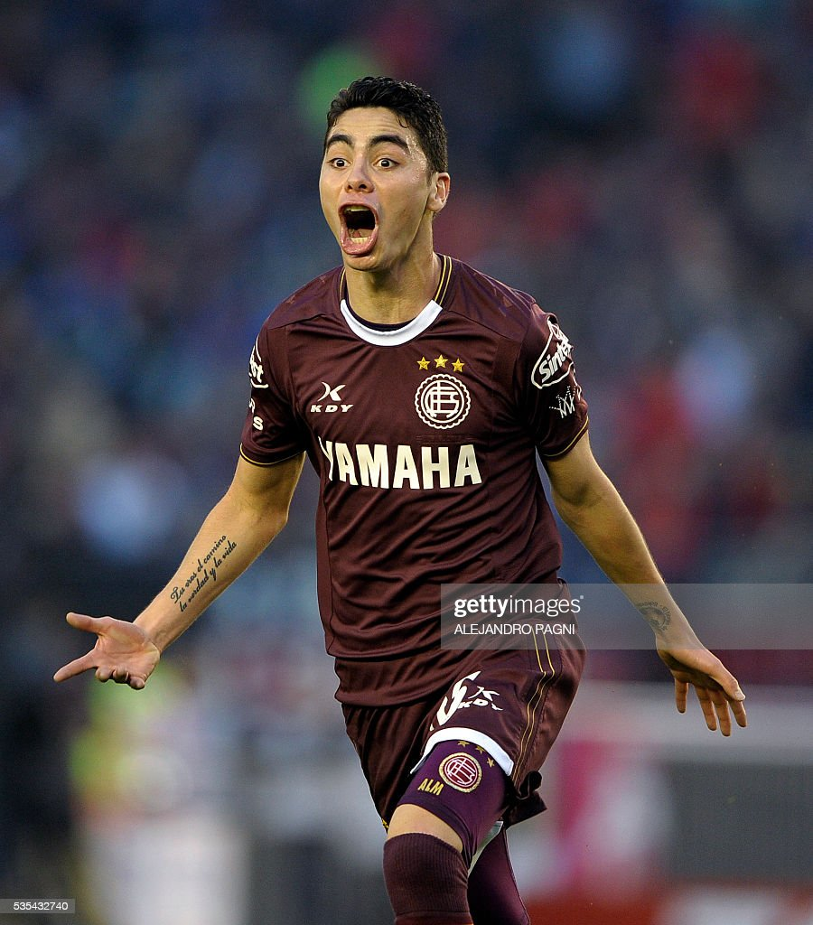 Lanus' midfielder Miguel Almiron celebrates after scoring the team's second goal against San Lorenzo during an Argentina First Divison football final match at the Momnumental stadium in Buenos Aires, Argentina, on May 29, 2016. / AFP / ALEJANDRO