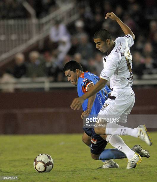 Lanus' player Guido Pizarro vies for the ball with Jose Chavez of Blooming during a Copa Libertadores soccer match on March 24 2010 in Buenos Aires...