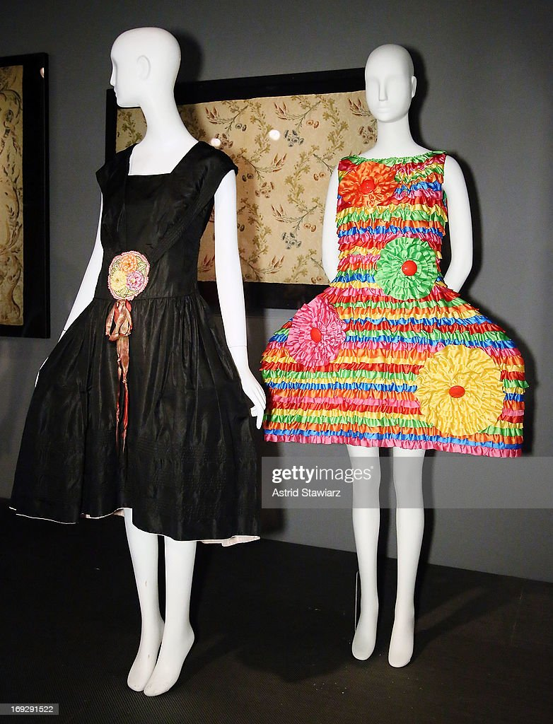 A Lanvin gown circa 1923 is displayed next to a Agatha Ruiz de la Prada, circa 2009 gown at the RetroSpective Press Preview at The Museum at FIT on May 22, 2013 in New York City.