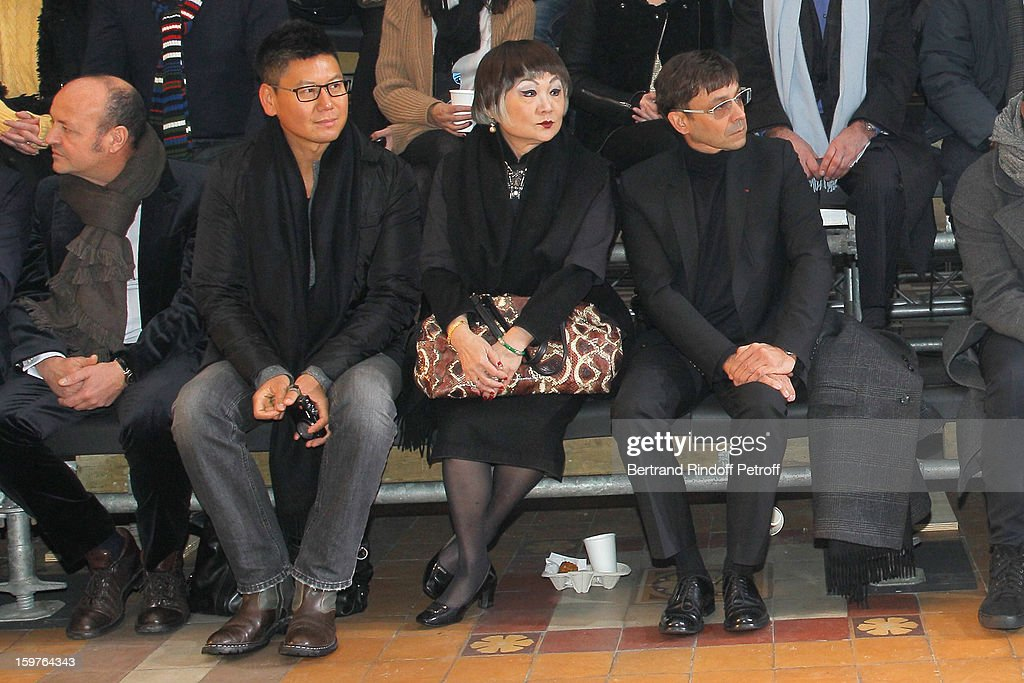 Lanvin's owner, Shaw Lan Wang (3rd L) and guests attend the Lanvin Men Autumn / Winter 2013 show at Ecole Nationale Superieure Des Beaux-Arts as part of Paris Fashion Week on January 20, 2013 in Paris, France.