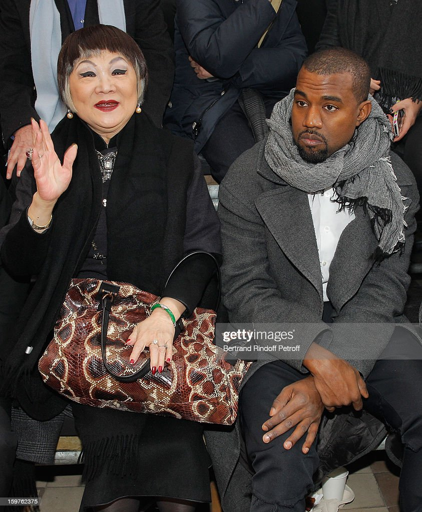 Lanvin's owner, Shaw Lan Wang (L) and Kanye West attends the Lanvin Men Autumn / Winter 2013 show at Ecole Nationale Superieure Des Beaux-Arts as part of Paris Fashion Week on January 20, 2013 in Paris, France.