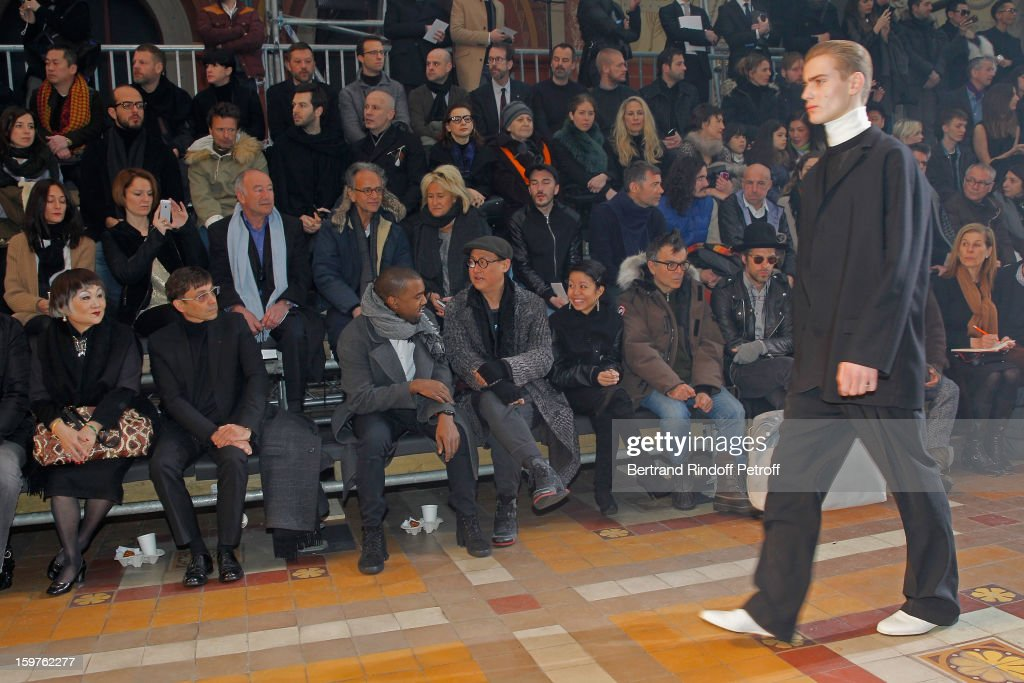 Lanvin's owner, Shaw Lan Wang, guest, <a gi-track='captionPersonalityLinkClicked' href=/galleries/search?phrase=Kanye+West+-+Musician&family=editorial&specificpeople=201803 ng-click='$event.stopPropagation()'>Kanye West</a>, Alex Koo, guest, sculptor Fabrice Hyber and <a gi-track='captionPersonalityLinkClicked' href=/galleries/search?phrase=Aaron+Young+-+Artist&family=editorial&specificpeople=2878752 ng-click='$event.stopPropagation()'>Aaron Young</a> attend Lanvin Men Autumn / Winter 2013 show at Ecole Nationale Superieure Des Beaux-Arts as part of Paris Fashion Week on January 20, 2013 in Paris, France.