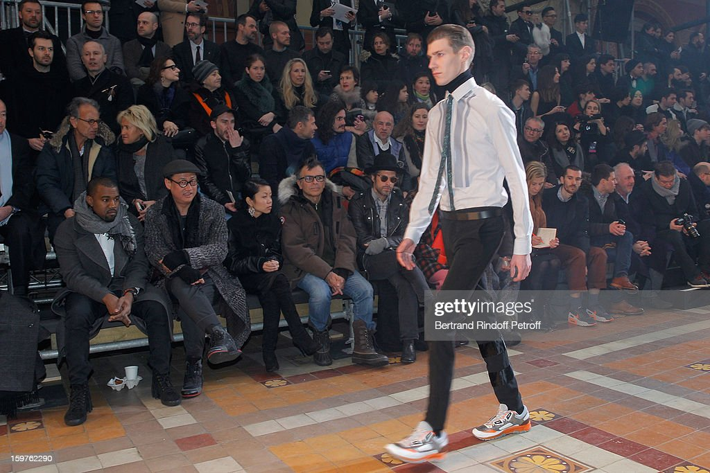 Lanvin's owner, Shaw Lan Wang, guest, <a gi-track='captionPersonalityLinkClicked' href=/galleries/search?phrase=Kanye+West+-+Musicista&family=editorial&specificpeople=201803 ng-click='$event.stopPropagation()'>Kanye West</a>, Alex Koo, guest, sculptor Fabrice Hyber and <a gi-track='captionPersonalityLinkClicked' href=/galleries/search?phrase=Aaron+Young+-+Artista&family=editorial&specificpeople=2878752 ng-click='$event.stopPropagation()'>Aaron Young</a> attend Lanvin Men Autumn / Winter 2013 show at Ecole Nationale Superieure Des Beaux-Arts as part of Paris Fashion Week on January 20, 2013 in Paris, France.