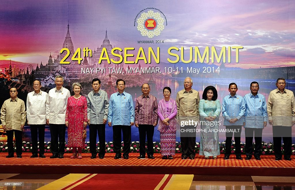 Lao Prime Minister Thongsing Thammavong (6L), Philippine President Benigno Aquino (5L), Singapore's Prime Minister Lee Hsien Loong (4L) and his wife (3L), Thai deputy Prime Minister Phongthepth Epkanjana (2L), Vietnam's Prime Minister Nguyen Tan Dung (L), Myanmar President Thein Sein (C) and his wife (R), Malaysian Prime Minister Najib Razak (1R) and his wife (2R), Sultan of Brunei Hassanal Bolkiah (3R), Cambodian Prime Minister Hun Sen (4R) and Indonesian President Susilo Bambang Yudhoyono (5R) pose for a photograph ahead of a welcome dinner as part of the 24th ASEAN summit at the Myanmar International Convention Center in Naypyidaw on May 10, 2014. Surging tensions in the South China Sea dominated a meeting of Southeast Asia's regional bloc, presenting a challenging diplomatic debut for Myanmar as it hosts the talks for the first time. AFP PHOTO/Christophe ARCHAMBAULT