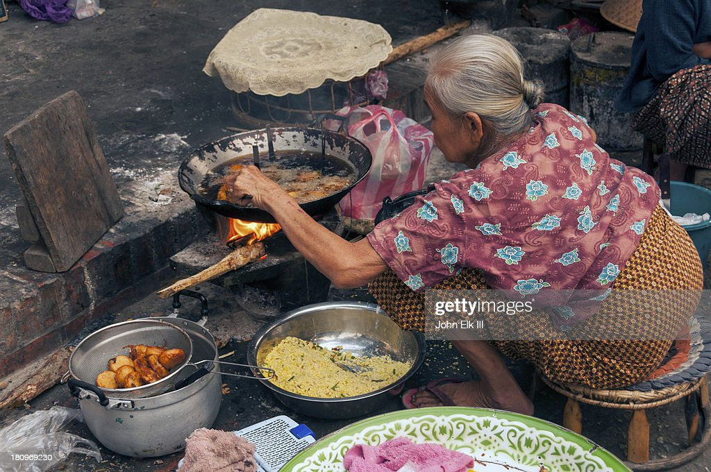 Lao woman cooking : Stock Photo