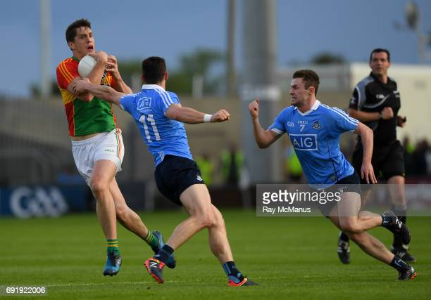Laois Ireland 3 June 2017 Brendan Murphy of Carlow in action against Diarmuid Connolly and Jack McCaffrey of Dublin during the Leinster GAA Football...