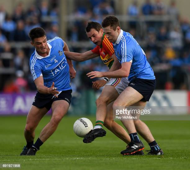 Laois Ireland 3 June 2017 Sean Gannon of Carlow in action against Eric Lowndes left and Jack McCaffrey of Dublin during the Leinster GAA Football...