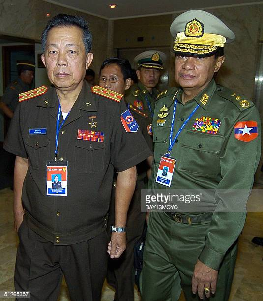 Laos and Myanmar army chief Brigadier General Kenekham Senglathone and vice senior General Maung Aye walk together after a meeting with Indonesian...