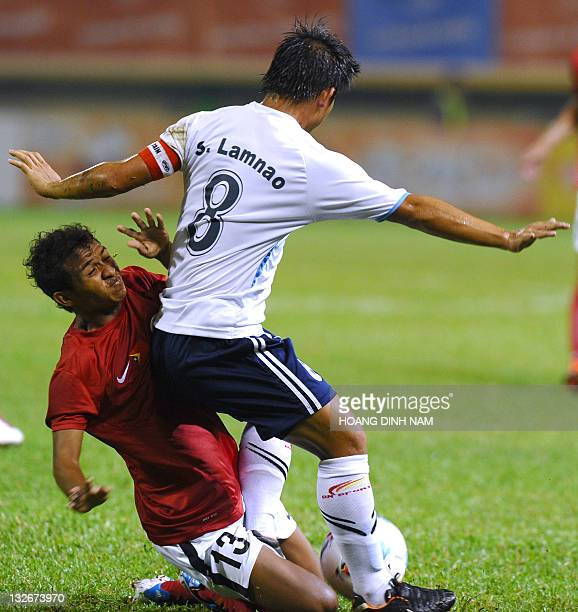 Lao's Lamnao Singto fights for the ball with Timor Leste's Emanuel Antonio Cabral Abel during the group B qualifying match against Timor Leste at the...
