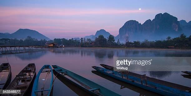 Laos, Mekong River, Boats in river at dusk