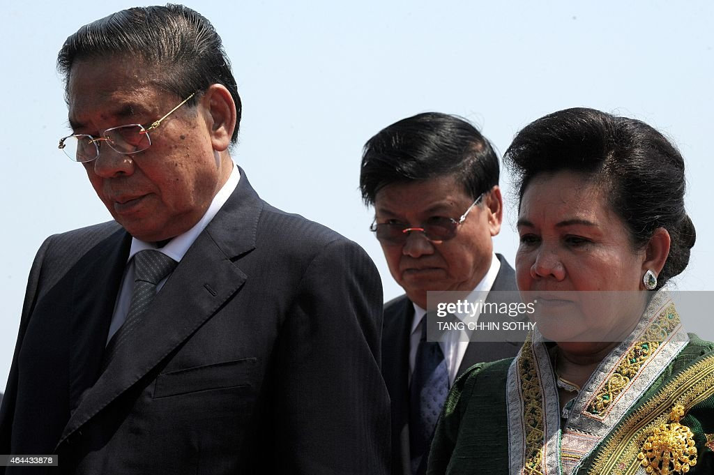 Laos President <a gi-track='captionPersonalityLinkClicked' href=/galleries/search?phrase=Choummaly+Sayasone&family=editorial&specificpeople=556173 ng-click='$event.stopPropagation()'>Choummaly Sayasone</a> (L) and his wife Keosaychay Sayasone (R) pay their respects in front of a statue of late former king Norodom Sihanouk during their visit in Phnom Penh on February 26, 2015. Choummaly arrived here for a two-day official visit.