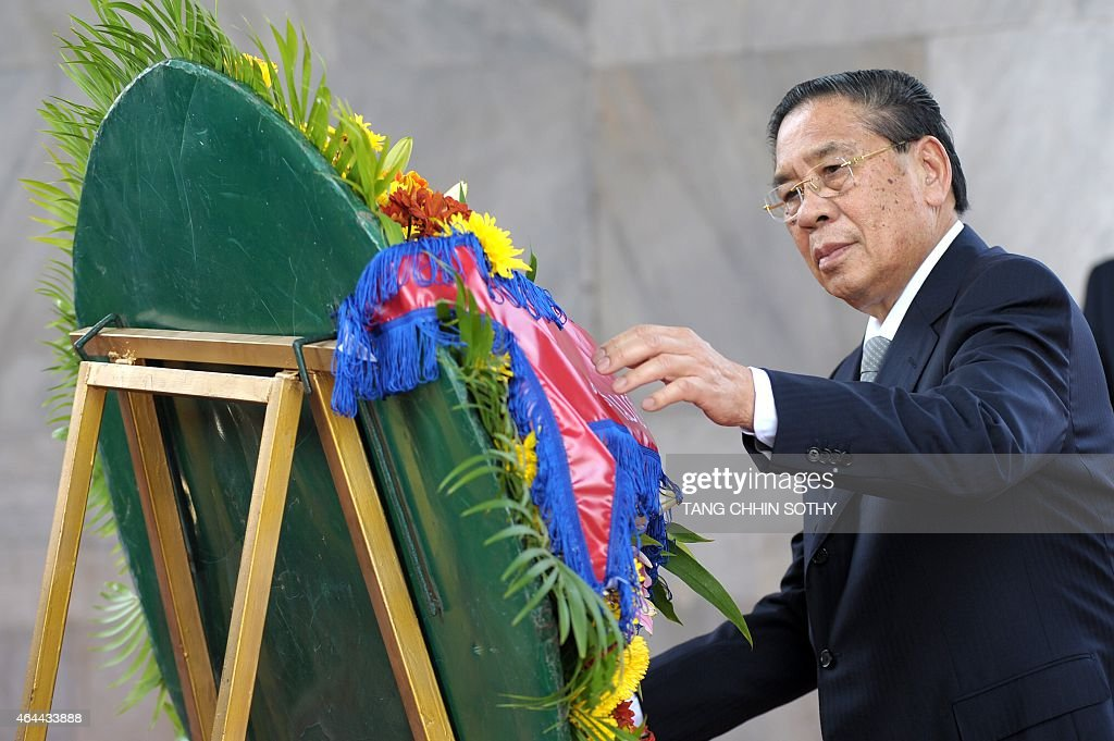 Laos President <a gi-track='captionPersonalityLinkClicked' href=/galleries/search?phrase=Choummaly+Sayasone&family=editorial&specificpeople=556173 ng-click='$event.stopPropagation()'>Choummaly Sayasone</a> pays his respects during a visit to the Independence Monument in Phnom Penh on February 26, 2015. Choummaly arrived here for a two-day official visit.