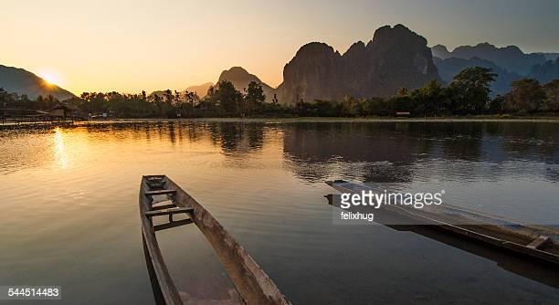 Laos, River boats at sunset