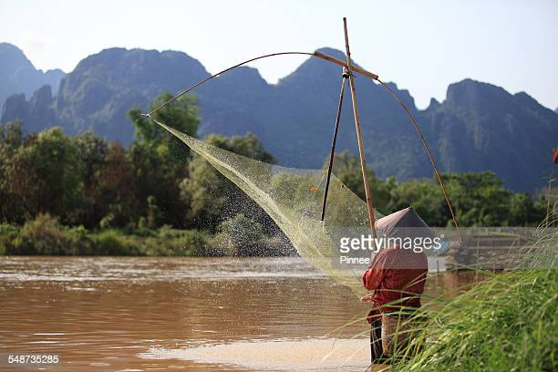 Laos traditional fishing with bamboo dip net, Laos